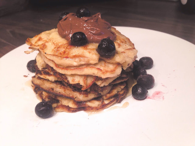 stack protein banana pancakes blueberries nutella syrup