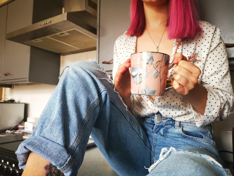 Girl-Sat-On-Counter-Drinking-Tea