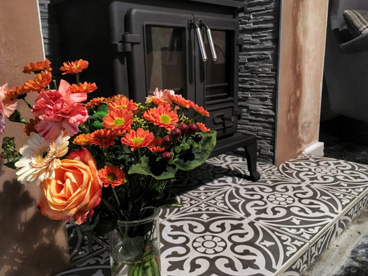 fireplace tons of tiles hearth patterned autumnal flowers